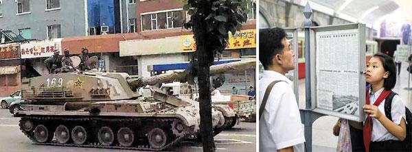중국군 대전차 자주포가 22일 중국 지린성 옌지 시내를 통과해 북·중 국경 지역으로 향하고 있다(왼쪽 사진). 오른쪽 사진은 고위급 접촉이 시작된 지난 22일 북한 평양 주민들이 지하철역 승강장 게시판에 걸린 신문을 읽고 있는 모습.