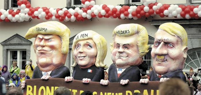 히틀러를 닮아간다고 비판받는 3인의 '자국 우선주의' 정치인. 지난 2월 독일 뒤셀도르프 축제에 등장한 트럼프 미 대통령, 르펜 프랑스 국민전선 대표, 빌더르스 네덜란드 자유당 대표, 그리고 히틀러 인형이다(왼쪽부터). 21세기의 민주주의가 권위주의와 파시즘에 굴복하고 있다는 우려가 커지고 있다.