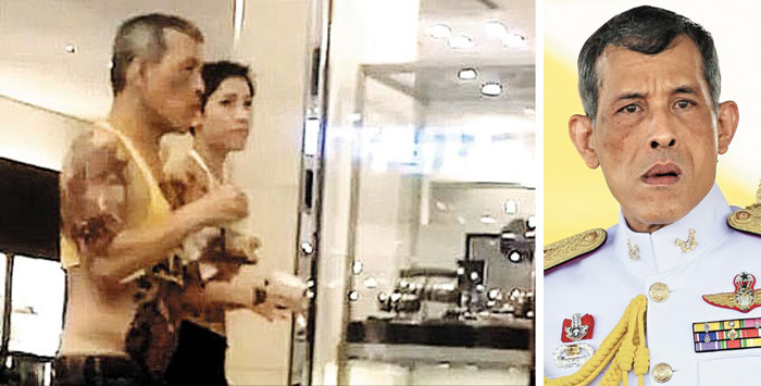 지난해 7월 독일 뮌헨의 한 쇼핑몰에서 마하 와치랄롱꼰 태국 국왕이 문신이 드러나는 배꼽티 차림으로 부인이 아닌 한 여성과 걷고 있다.
