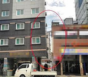 부산 사하구의 9층짜리 오피스텔 건물(왼쪽)이 왼쪽으로 기운 모습. 16가구 주민은 대피한 상태다.