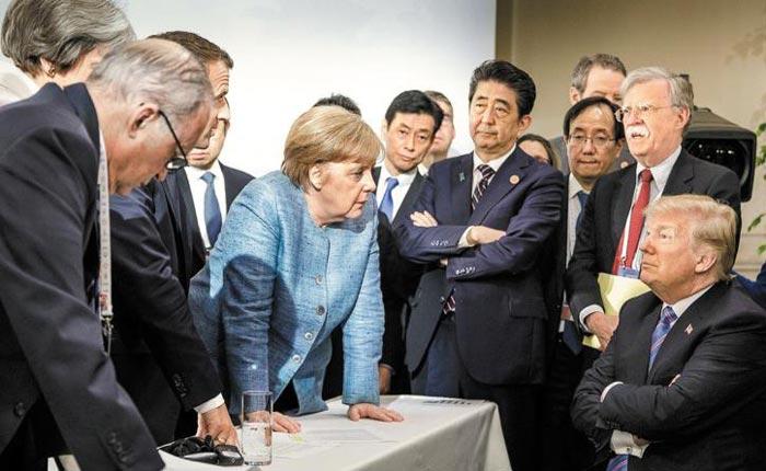 메르켈은 쏘아보고, 트럼프는 팔짱끼고, 아베는 답답하고… 쪼개진 G7