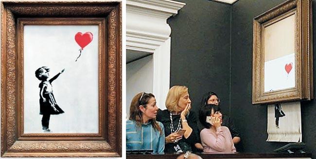 뱅크시의 그림'풍선과 소녀'가 경매 낙찰과 동시에 파쇄되고 있다.