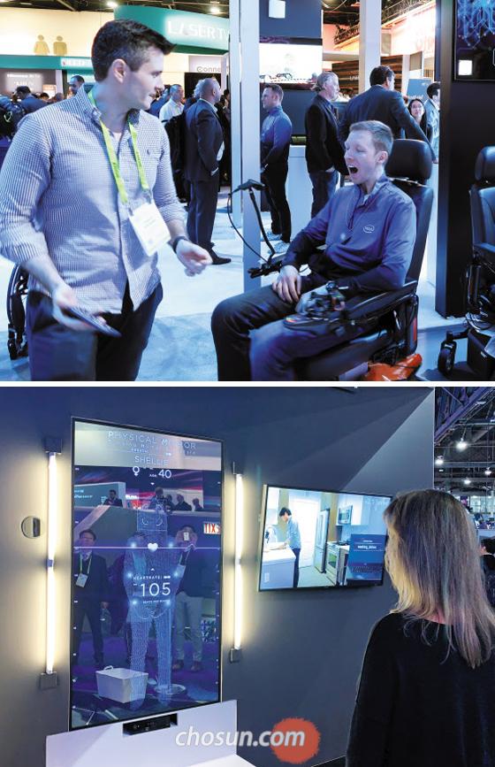 9일(현지 시각) CES가 열린 미국 라스베이거스 컨벤션센터에서 한 관람객이 인텔의 표정 제어 휠체어를 체험해보고 있다(위 사진). 이 휠체어는 AI가 얼굴 표정을 분석해 작동한다. 아래 사진은 파나소닉의 거울형 건강 측정기 앞에 선 관람객이 자신의 건강 상태를 체크하고 있는 모습.