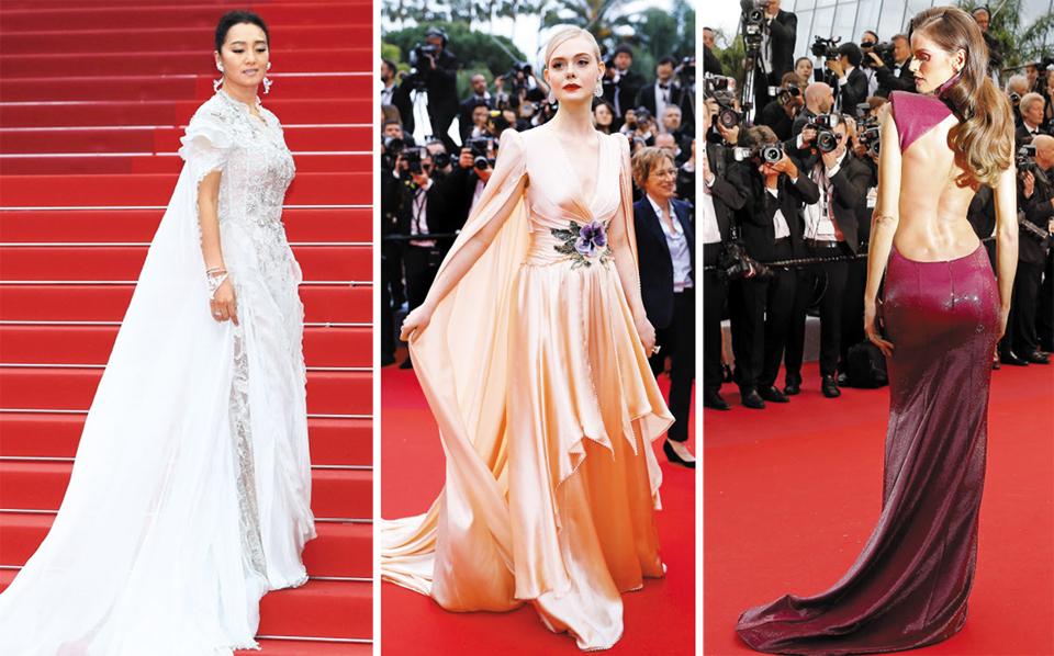 (사진 왼쪽부터)14일(현지 시각) 프랑스 칸 영화제 개막식에 참석한 배우 궁리, 망토가 달린 드레스를 걸친 칸 영화제 최연소 심사위원이자 배우인 엘르 패닝, 등이 파인 보랏빛 드레스를 입은 브라질 출신의 모델 겸 배우 이자벨 굴라르.