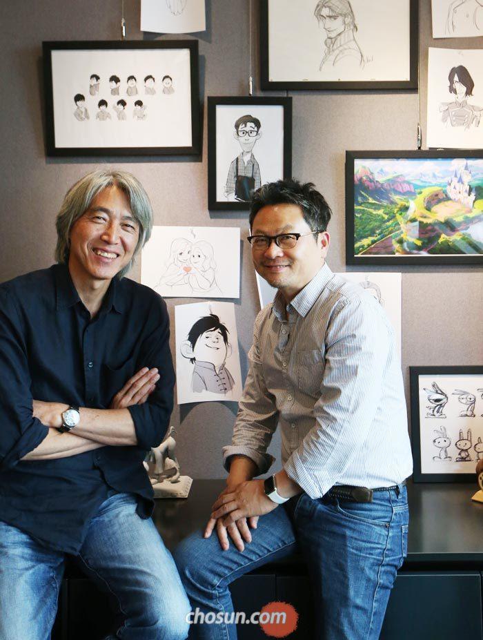 11일 오후 서울 논현동 로커스 스튜디오 사무실에서 홍성호(오른쪽) 총감독과 김상진 감독이 국산 3D애니메이션 '레드슈즈' 작업 당시 그린 그림을 배경으로 앉아 있다.