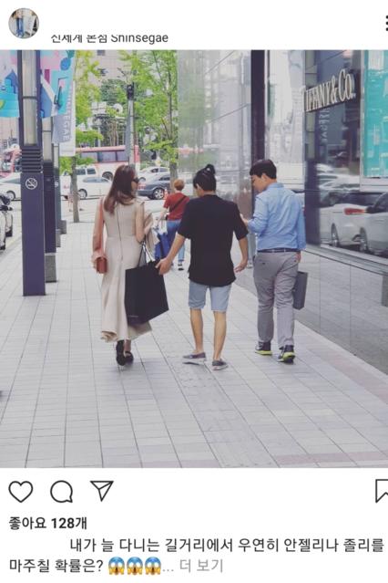앤젤리나 졸리가 서울 중구 소공로 신세계백화점 본점 앞을 아들 매덕스와 함께 지나가고 있다./인스타그램 캡처
