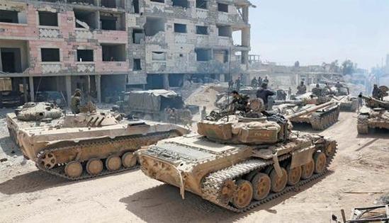 시리아 정부군이 전차를 앞세우고 반군의 마지막 거점 동구타 두마 지역 외곽에 집결해 있다. /조선DB