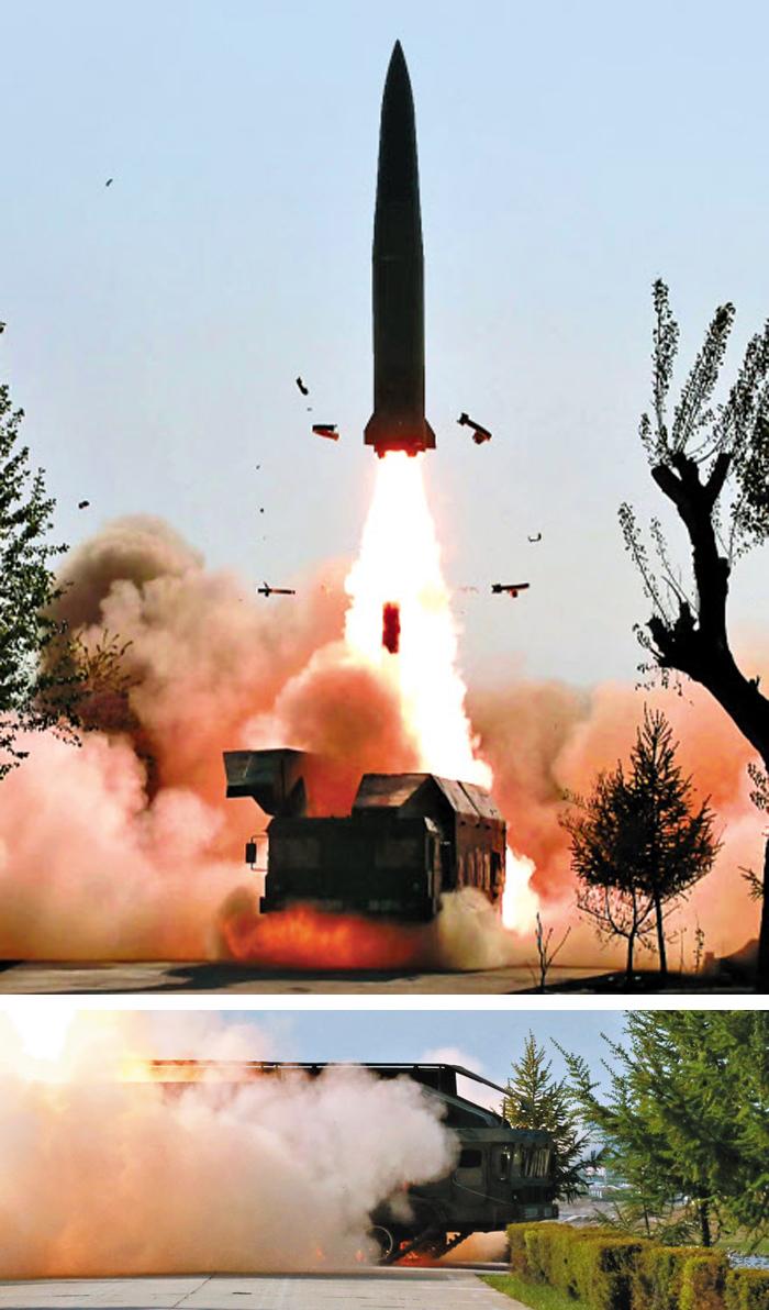 이번엔 무한궤도형 발사대서 쐈다 - 북한이 지난 9일 평안북도 구성에서 이스칸데르급 미사일을 발사하는 장면을 10일 공개했다. 지난 4일 강원도 원산에서 발사할 땐 바퀴가 달린 이동식 발사대가 등장했고, 이번엔 무한궤도형(아래 사진) 발사대가 사용됐다. 언제 어디서든 미사일을 쏠 수 있는 능력을 과시한 것이다. 전문가들은 이스칸데르급 미사일의 정점 고도가 낮고 비행 궤적이 불규칙해 요격이 어렵다고 분석했다.