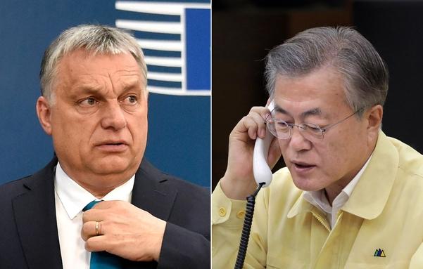 문재인 대통령이 30일 오후 청와대에서 빅토르 오르반 헝가리 총리(왼쪽)와 유람선 사고 관련 통화를 하고 있다. /청와대 제공·AP연합뉴스
