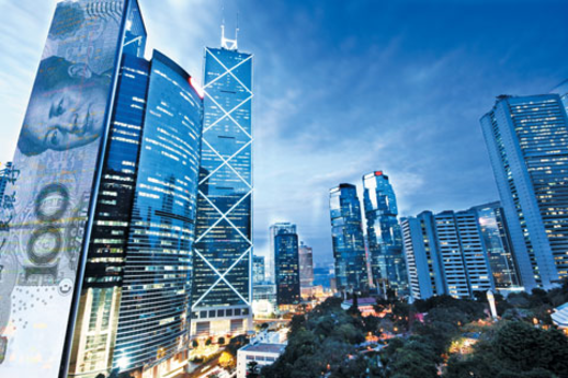 홍콩섬 중심가인 센트럴(中環)에 있는 금융가 야경(夜景)과 마오쩌둥(毛澤東) 얼굴이 그려진 100위안짜리 위안화 합성 이미지 모습. /Shutter Stock