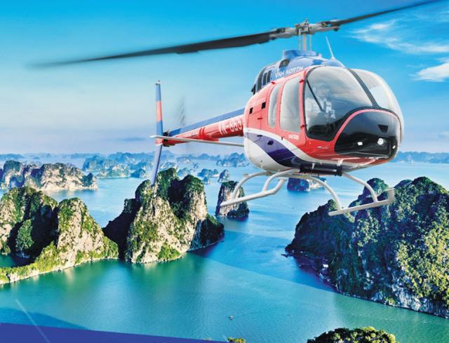 베트남 차량 공유 업체인 패스트고(FastGo)가 올해 새로 출시한 헬리콥터 공유 서비스 홍보물. 헬리콥터가 베트남의 유명 관광지인 할롱베이 상공을 날고 있다.