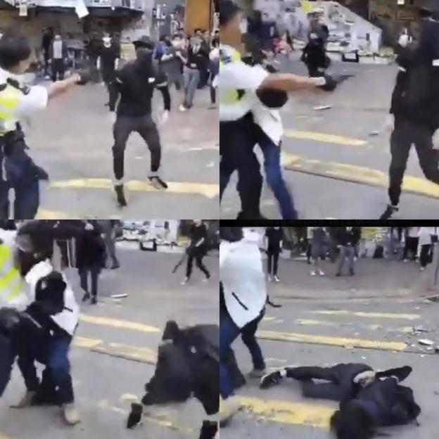 11일(현지 시각) 홍콩 사이완호에서 반중 시위대와 몸싸움을 벌이던 경찰이 검은 복면을 쓴 다른 시위대가 자신에게 접근하자 복부 쪽에 총을 쐈다/트위터 캡처