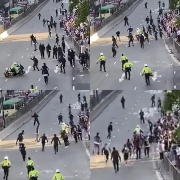 11일(현지 시각) 홍콩 콰이퐁 지역에서 오토바이를 몰던 한 경찰이 시위대를 향해 돌진하며 위협하고 있는 모습./트위터
