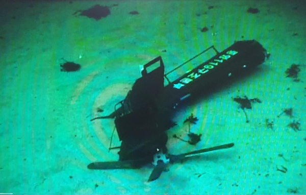 The tail of a fire helicopter taken from a navy blue sea underwater UAV. The Accident Investigation Committee believes that the helicopter's black box will be in this tail. Shipping